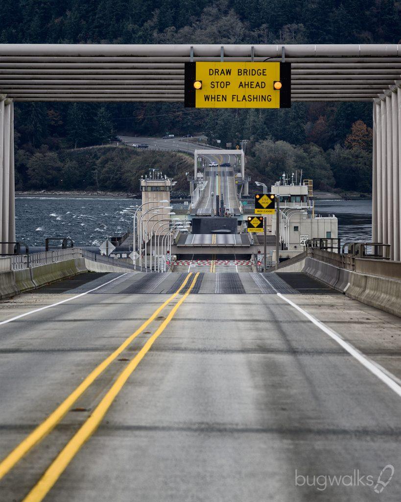 sub crossing through Hood Canal Bridge
